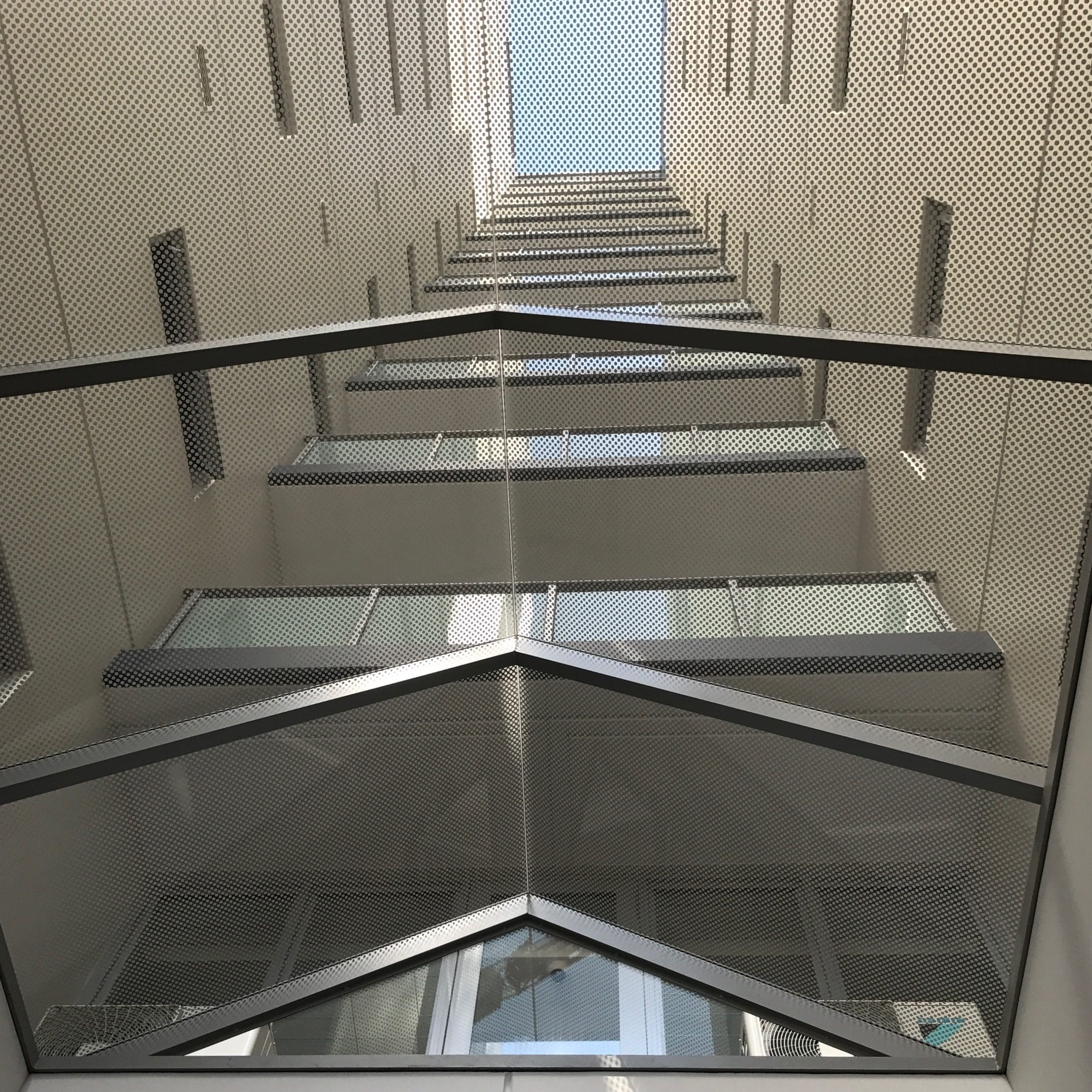 Glass printed canopy with white dots to provide transparency yet shading in Sydney apartments