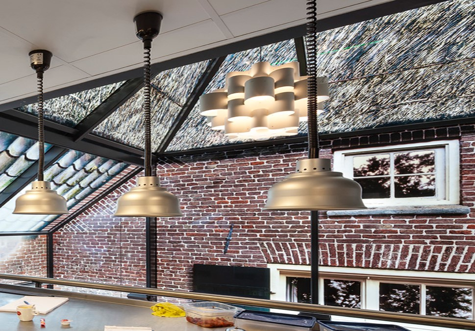 Glass printed straw roof and brick wall textures to replicate traditional Dutch farm using glass printing in The Netherlands
