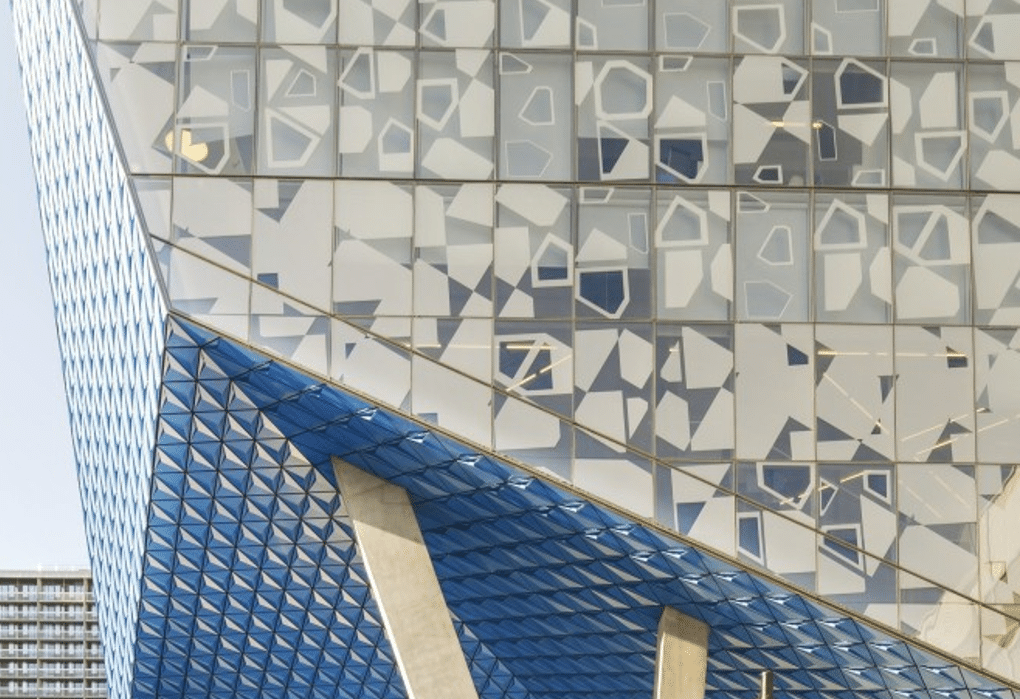 White geometric pattern printed on building façade of Ryerson University Student Learning Centre to control level of lighting