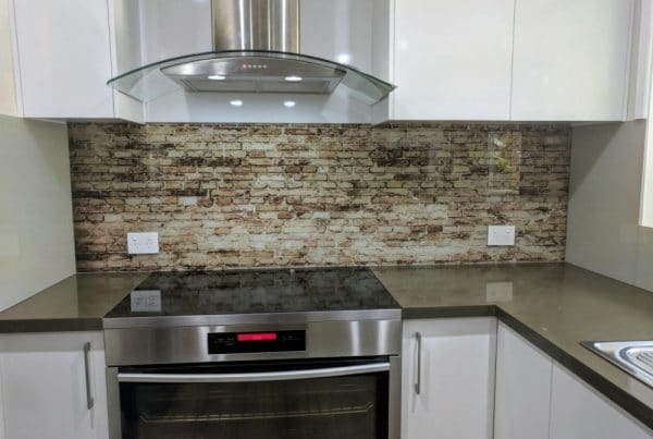 Brown brick texture printed on a residential glass splashback in the kitchen