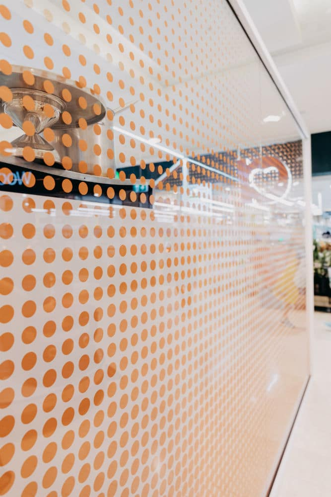 Acme Bakery in Bondi Junction Westfield with printed glass fitout using pink polka dots for decor and privacy - closeup