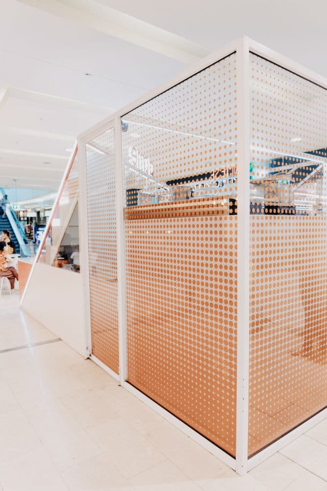 Acme Bakery in Bondi Junction Westfield with printed glass fitout using pink polka dots for decor and privacy - side view